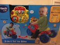 Brand new in sealed box Vtech trike to bike.