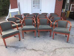 SEVERAL SOLID WOOD BASE CHAIRS WITH GORGEOUS MATERIAL ON WHEELS