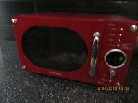 MICROWAVE OVEN AS NEW EXCELLENT CONDITION AND GOOD LOOKS WILL LOOK STRIKING IN A KITCHEN £50.