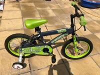 Boys bike with stabilisers.