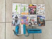 Blue Wii 2 controllers and Mario kart plus more