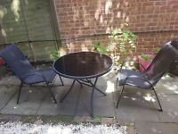 SOLD. Garden table 4 chairs and parasol