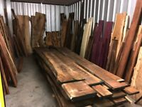 "Prime grade waney edge 1"" rough sawn American black walnut boards, price per cubic foot."