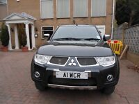 L200 mItsubishi Barbarian Double Cab 4x4 long bed pickup with canopy