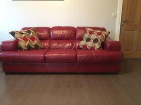 Reid's- Dark Red Leather 3 Seater Sofa (Used in good condition)