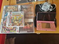 Nintendo 3DS with 5 games and charger.