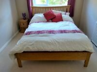 Solid oak double bed frame with matching bedside table