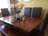 Beautiful solid wood dining table, matching bench and 4 chairs.