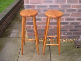 Two tall pine stools.
