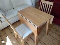For sale: dining table and two chairs