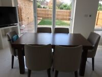 Walnut 6-8 seater extending dining table with 6 chairs