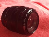 canon zoom lens EF 35-70mm 1:3.5-4.5 plus Niko LMC-Sky 52mm Lens Filter worth about £10