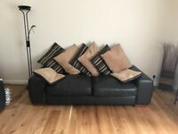 Two chocolate leather sofas with footstool