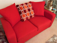 DFS 2 Seater Sofa Bed Pillow Back in Red/Orange Colour - Hardly Used