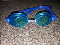 Various kids swimming goggles. girls and boys