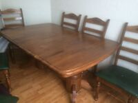 Solid New Zealand wood extendable Dining Table with 6 Chairs in excellent condition £200