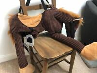 A strap on horse costume