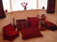red cushions, red flowers, red ornaments