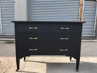 Black colour large chest of drawers legs on castors vintage