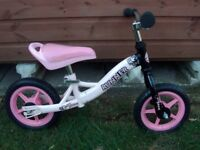 ADAMS RUNNER BALANCE BIKE IN PINK/BLACK. IDEAL XMAS BOX