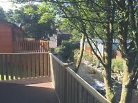 Centre Lounge Holiday lodge with RiverSide Views large Decking Lake District Windermere Limefitt