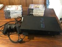 PlayStation 2 with all cables, 2 controllers and 14 games. All tested and working.