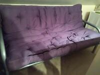 Sofa bed with blue pad and metal frame