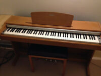 Yamaha Arius YDP-131 Digital Piano in cherry wood / light oak finish