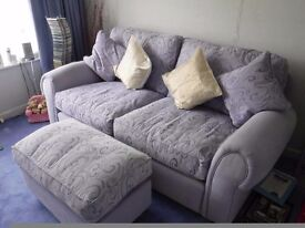 Nice two seat sofa and footstool in great condition