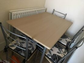 Like New. Table with 4 chairs