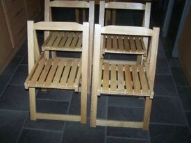 set of 4 wooden fold away chairs brand new not used