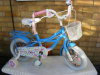 """GIRLS RALEIGH 12"""" WHEEL BIKE WITH FITTED STABILISERS IN GREAT CONDITION AGE 3+"""