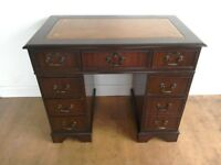 Antique style reproduction desk with leather top.