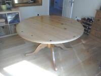 Bespoke round pine dining table.
