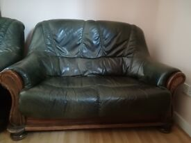 Forest green real leather sofa only, used but in reasonable condition