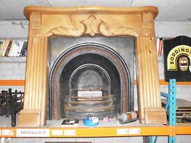 VINTAGE CAST IRON INSET FIREPLACE WITH CALVED WOOD SURROUND