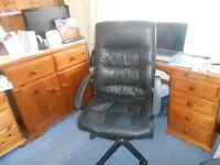 Desk chair black swivels and adjusts