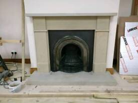 Cast iron fireplace with stone surround and hearth