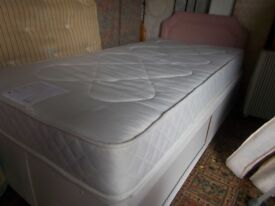 A John Lewis single divan with storage