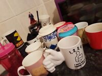 assorted collection of mugs
