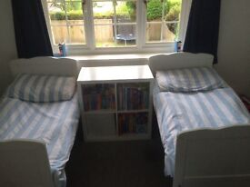 Toddler twin beds . Mattresses in excellent condition with baby blue striped bedding