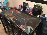 Metal frame dining table with glass top and 4 chairs