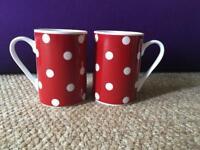 Matching red and white polka dot mugs