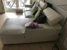 White leather corner sofa for sale with cushions.