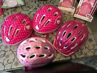 FOUR girls bicycle helmets