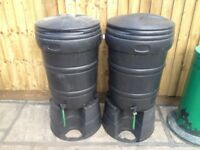 A pair of garden water butts