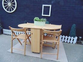 PINE BUTTERFLY DINING TABLE WITH 4 PINE FOLDAWAY CHAIRS EXTREMELY USEFUL TABLE NOW FOR CHRISTMAS