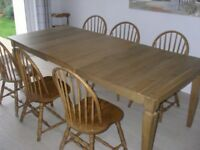Dining table, light oak, extends to seat 6 to 12 people. Absolute bargain!