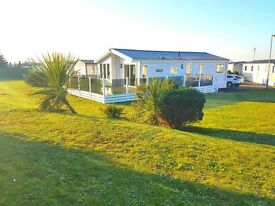 Luxury lodge with beautiful corner plot, garden and stunning views of the local village, Porthcawl