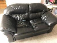 Two seat black leather sofa